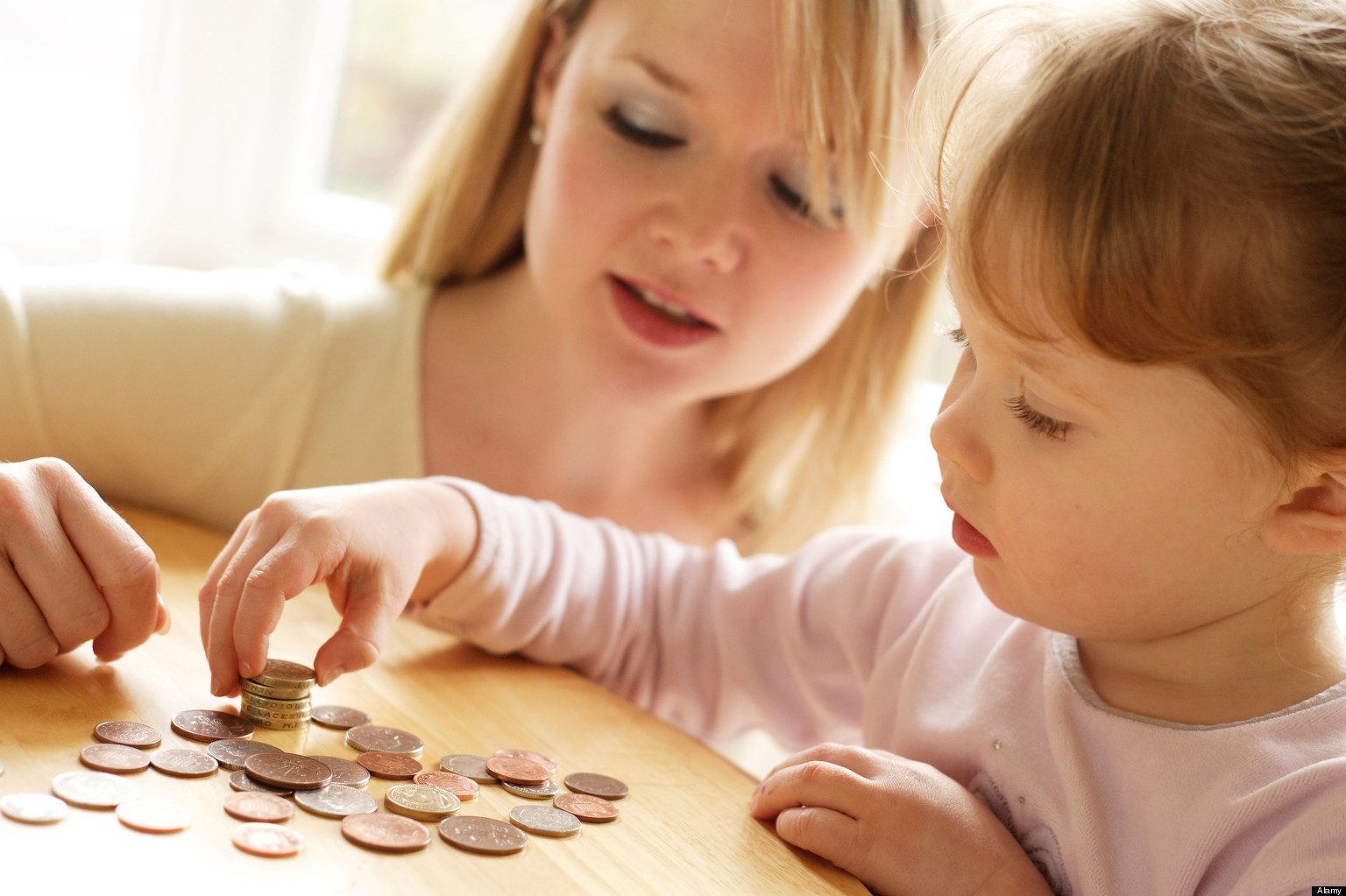 Mother and daughter counting money